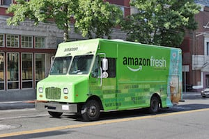 Photo of an Amazon Fresh grocery delivery truck - Amazon Fresh also answers the question