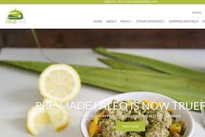 This is a screenshot of the True Fare home page. As is prominently displayed on their website, Truefare is the champion of Whole30 delivery. They have partnered with the official organization to offer Whole30 compliant meals, Whole30 snacks and Whole30 takeout options. They offer several Paleo food delivery service menus, such as menu's focusing on wild game meats, wild seafood, AIP meals, fresh Paleo meals, frozen Paleo meals, etc. Truefare meals are crafted by their head chef, Richard Bradford, who is also the author of several of the official Whole30 cookbook lines. In our article we provide links to Truefare meals photos and review articles.