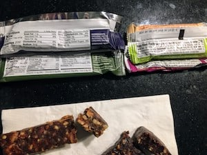 Photo of the back of Freedom Bars and Larabars - to help you compare what makes a Larabar organic vs a Freedom Bar organic.